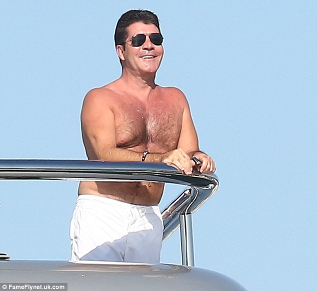 This is the life: Simon Cowell relaxes aboard a yacht in St Tropez today