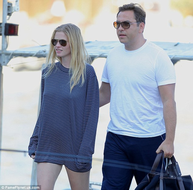 Cheeky! David Walliams and wife Lara Stone were spotted boarding Sir Elton John's yacht where the comedian tweeted that he 'mooned' Cowell