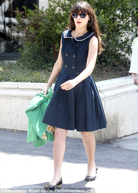 A bit of shopping: Zooey Deschanel showed her porcelain skin on a sultry LA day
