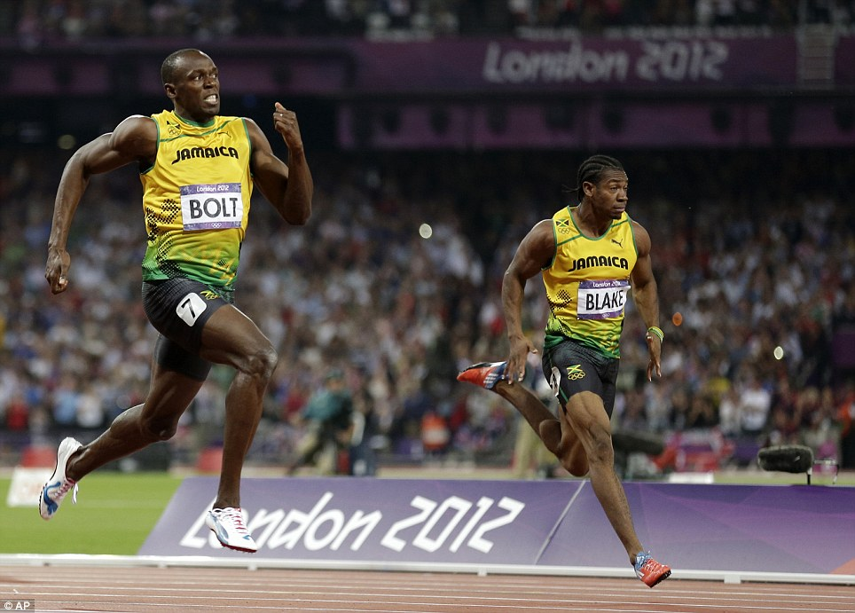 No world record: Bolt glances at the official clock as he powers towards the finish line