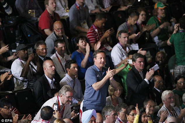 Raised the roof: David Cameron was also among the thousands of spectators who roared Adams to victory in London's ExCel