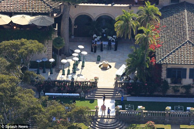 Coveted invite: The 440 guests were greeted by lavish décor and uniformed waiters offering cocktails as they arrived