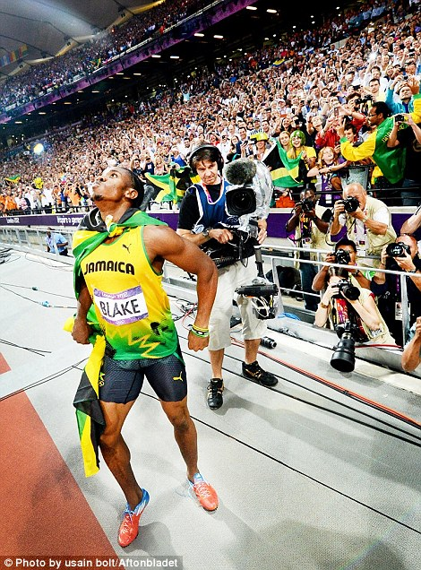 Usain Bolt using photographer Jimmy Wixtr's camera who was covering the Olympics for Swedish paper Aftonbladet