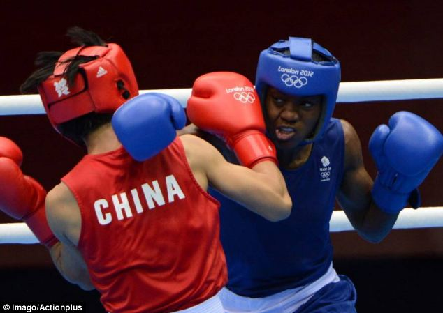 History: Great Britain's Nicola Adams becomes the first woman to win Olympic boxing gold after victory over Ren Cancan at ExCeL