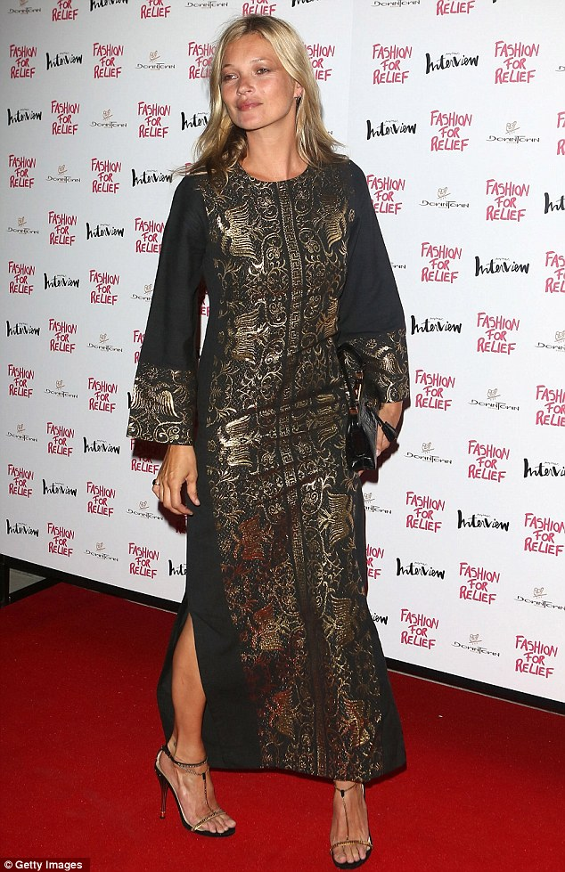 The big names: Kate Moss arrived in a long black tunic with gold designs on it sporting a rather tanned pair of legs