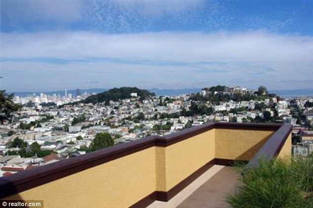 The skyline of San Francisco is visible from the top of the home that Evan Williams wants to demolish