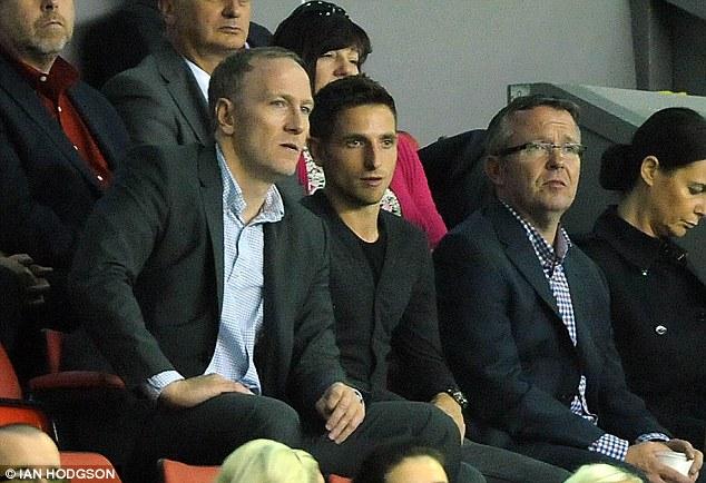 Done deal: Joe Allen watches Liverpool's Europa League tie on Thursday night