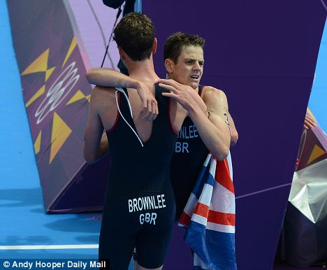 Oh brother: Alistair Brownlee (left) consoles brother Jonny, who won bronze