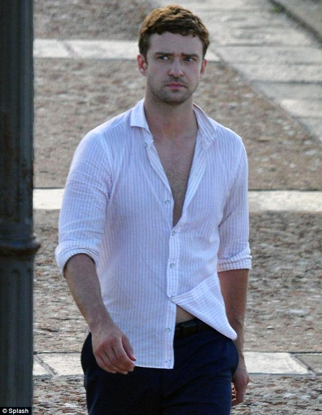 Timberpecs: As Justin Timberlake sauntered on to the Puerto Rican set of his new film Runner, Runner, he was seen barely wearing the snugly fit white shirt showcasing the star's defined pecs and flash of chest hair