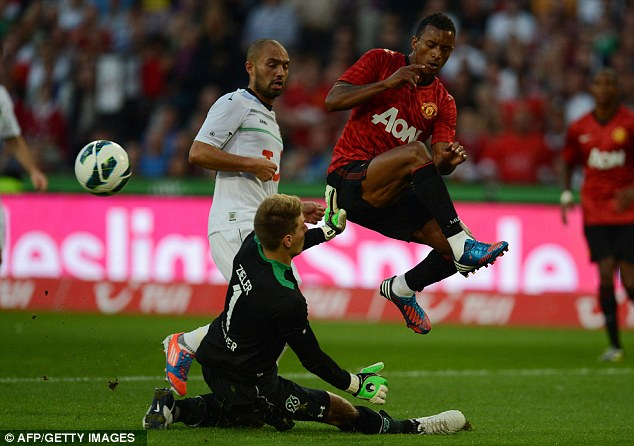 Watch out: Nani jumps out of the way of Hannover goalkeeper Ron-Robert Zieler