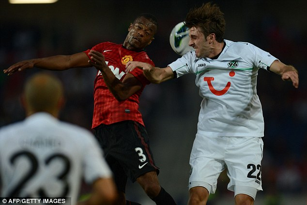 Heads up: Patrice Evra challenges Adrian Nikci for the ball in the warm-up clash