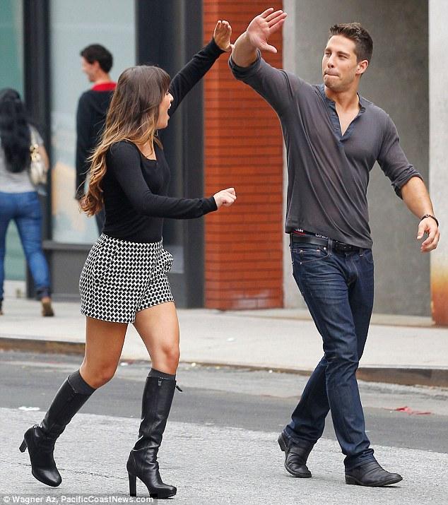 Nice job, dude: Lea high-fives her co-star
