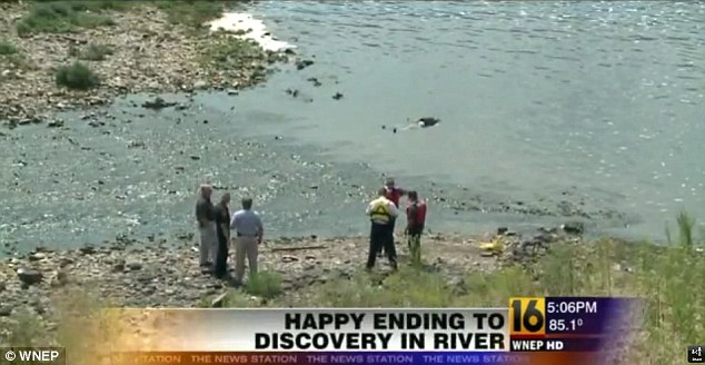 Forensic officials and police discuss how best to extract the 'body' of Joseph DeAngelo from the waters of the Susquehana River in Pennslyvania