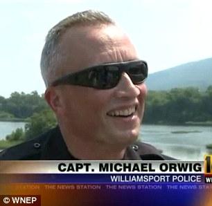 Williamsport Police Captain Michael Orwig (left) and onlooker nlooker Matthew Kranz were pleased to have seen Mr. DeAngelo rise from the dead