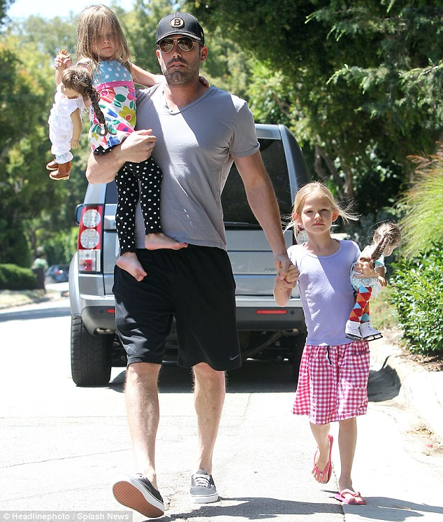 American family: The 39-year-old actor was seen juggling his young daughters Seraphina and Violet, who have obviously caught on to the American Girl Doll craze