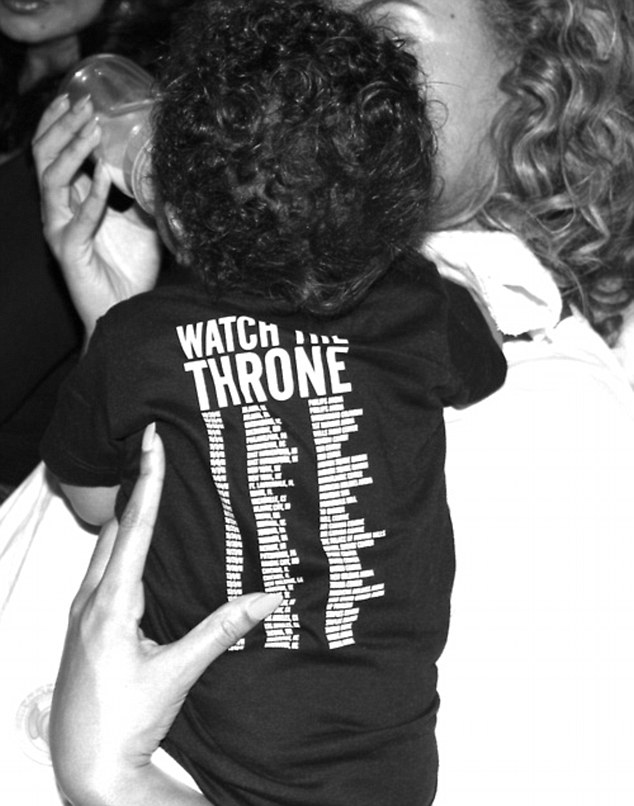 Daddy's girl: Beyonce posted a photo of herself bottle feeding daughter Blue Ivy on her Tumblr account as she opened up her family album; the tot wore a shirt promoting father Jay Z's tour with Kanye West