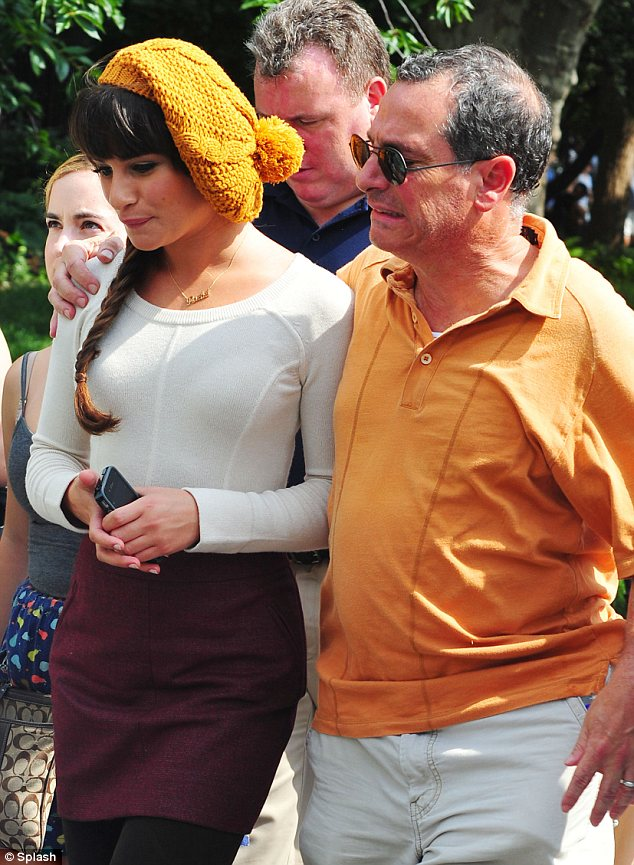 Close bond: Lea received a visit from her father Marc Sarfati on set who proudly put his arm around her