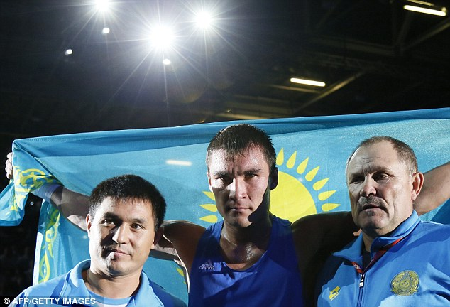 Fly the flag: Sapiyev celebrates his victory