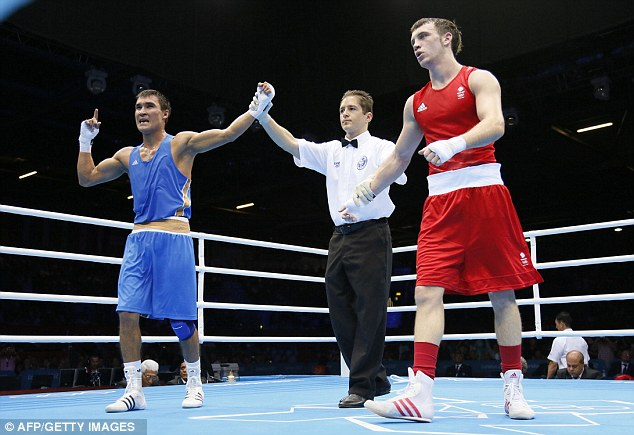 Clear cut: Serik Sapiyev of Kazakhstan (left) is declared gold medal victor over Fred Evans of Great Britain