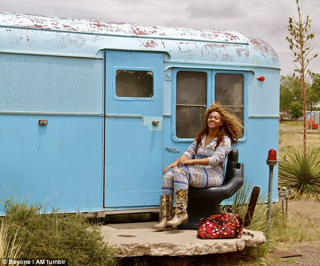 Home sweet home! Beyonce poses in front of an old mobile home, a far cry from her own luxury lifestyle