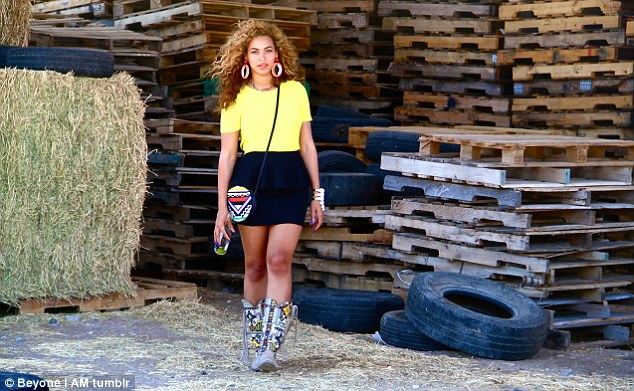 Perfectly styled: Beyonce never looks less than perfect, seen here having a drink of water on the set of a music video