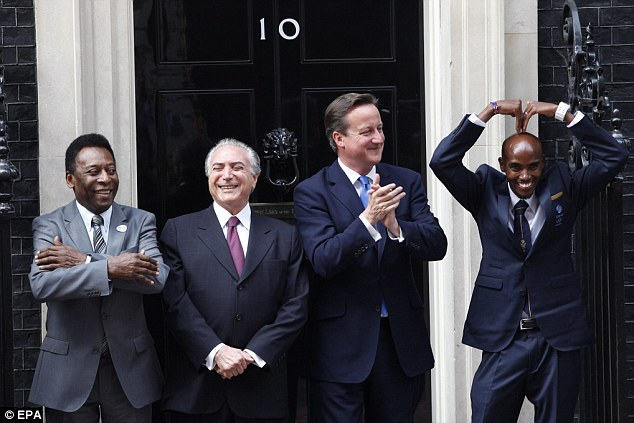 Catching on: Mo Farah does the Mobot alongside Pele and David Cameron at Downing Street