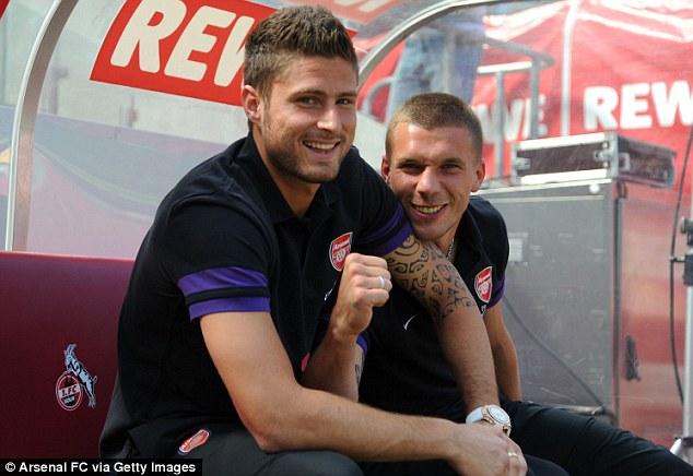 Welcome: Olivier Giroud, another summer signing was on show alongside Podolski