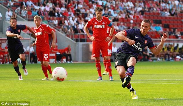 Spot on: Lukas Podolski scored twice in his first Arsenal game, their final pre-season fixture