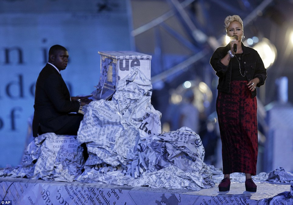 Back on song: Emeli Sande, who sang Abide With Me during the Opening Ceremony, performs on the newspaper-covered stage