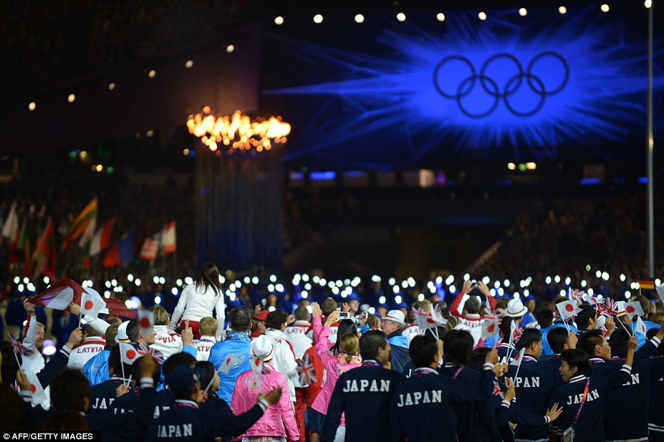 Athletes enter the Olympic stadium during the closing ceremony