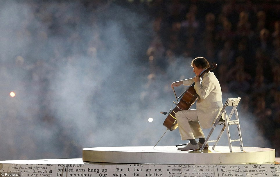 From classical to pop: Julian Lloyd Webber plays the cello during the closing ceremony, which celebrated music across the centuries, as well as the decades