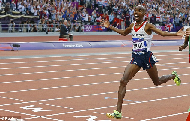 Ecstatic: Farah reacts as he crosses the finish line to win gold in the men's 5,000m final