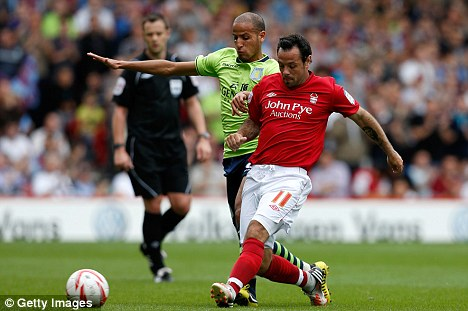El Ahmadi gets stuck in to Nottingham Forest's Andy Reid during a pre-season encounter