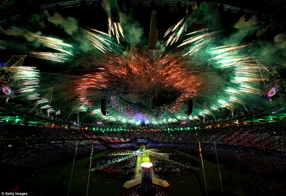 Spectacle: Bright reds, greens and golds break out above the Olympic Stadium during the closing ceremony