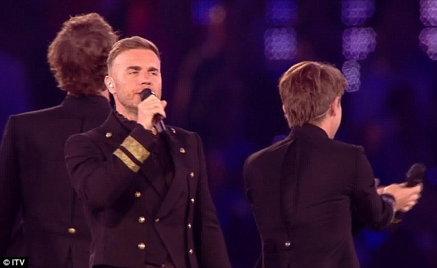 Hiding the pain: Gary put on a brave face to perform at the once-in-a-lifetime event