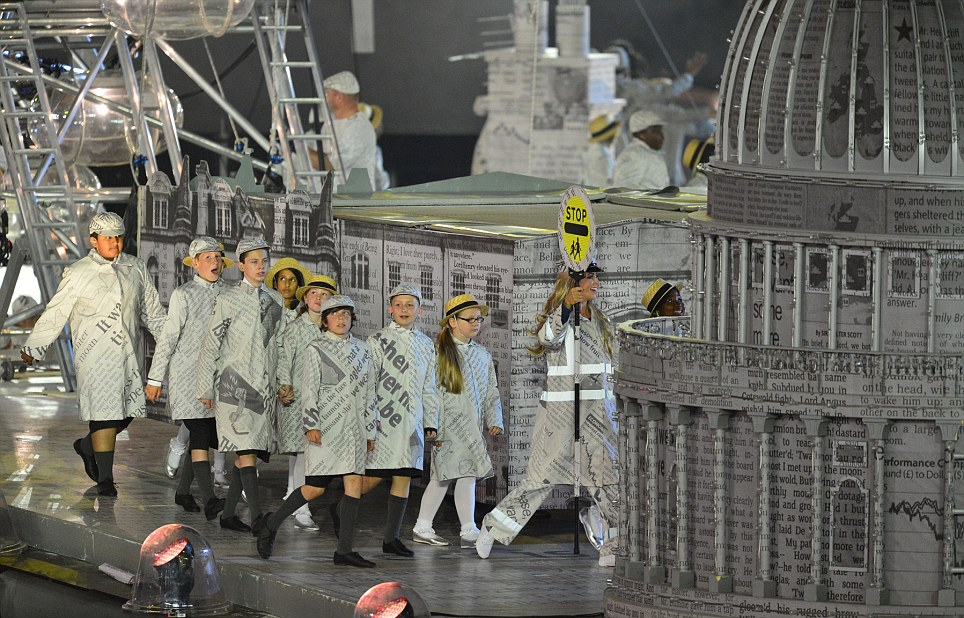 Actors parade around the model of St Paul's wrapped in newsprint, during the opening stages of the closing ceremony