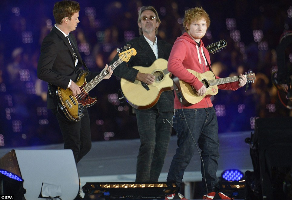 British singer Ed Sheeran performs Pink Floyd's Wish You Were Here, accompanied by Mike Rutherford and The Feeling's Richard Jones