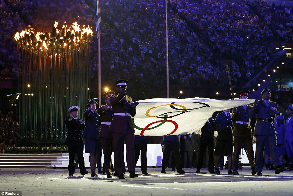 End of an era: The Olympic flag is lowered by representatives from the Army, Navy and Royal Air Force