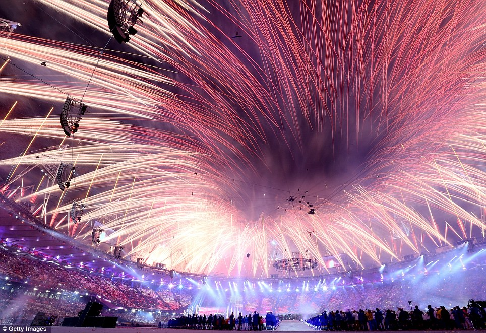 Light show: Rockets shoot above the Olympic stadium in one of the most spectacular displays ever seen in Britain