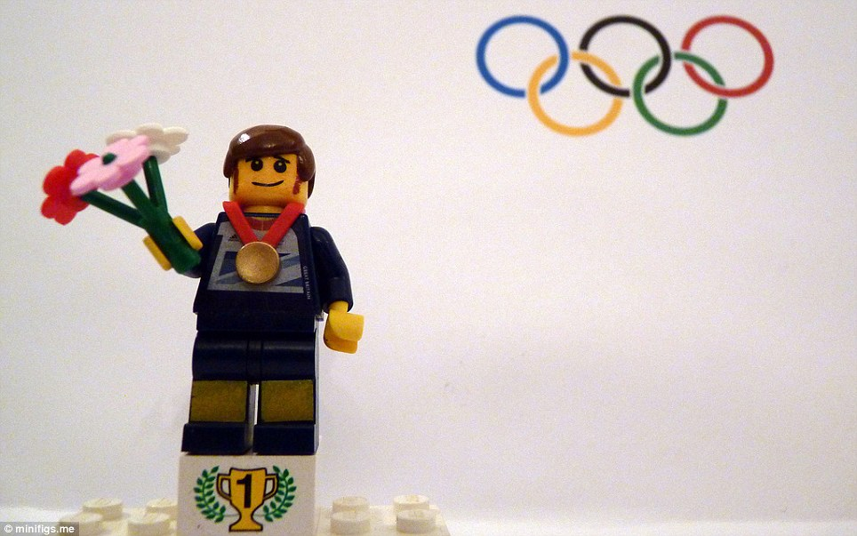 Lego cyclist Bradley Wiggins collects his gold medal on the podium after the road race