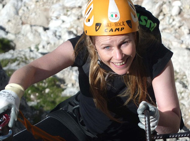 Laura holds on for dear life as she tackles a sheer vertical stretch on the Via Ferrata degli Alpini's 'intermediate' route