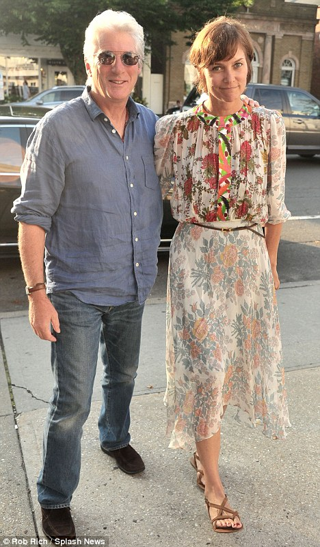 A blissful moment: Richard Gere seemed to be in nirvana when he attended a screening of his latest movie Arbitrage with wife Carey Lowell in London tonight