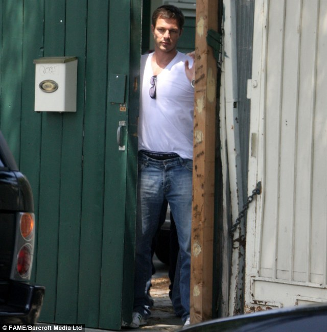 Levi's and Land Rover model Paul Sculfor leaves his home after spending the night at Jennifer Aniston's home