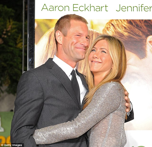 Aaron Eckhart and Jennifer Aniston arrive at the premiere of 'Love Happens'