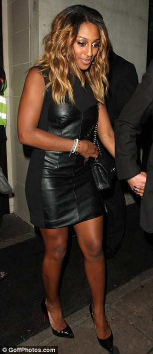 Hell for leather: The singer was wearing a leather pannelled dress for her night out