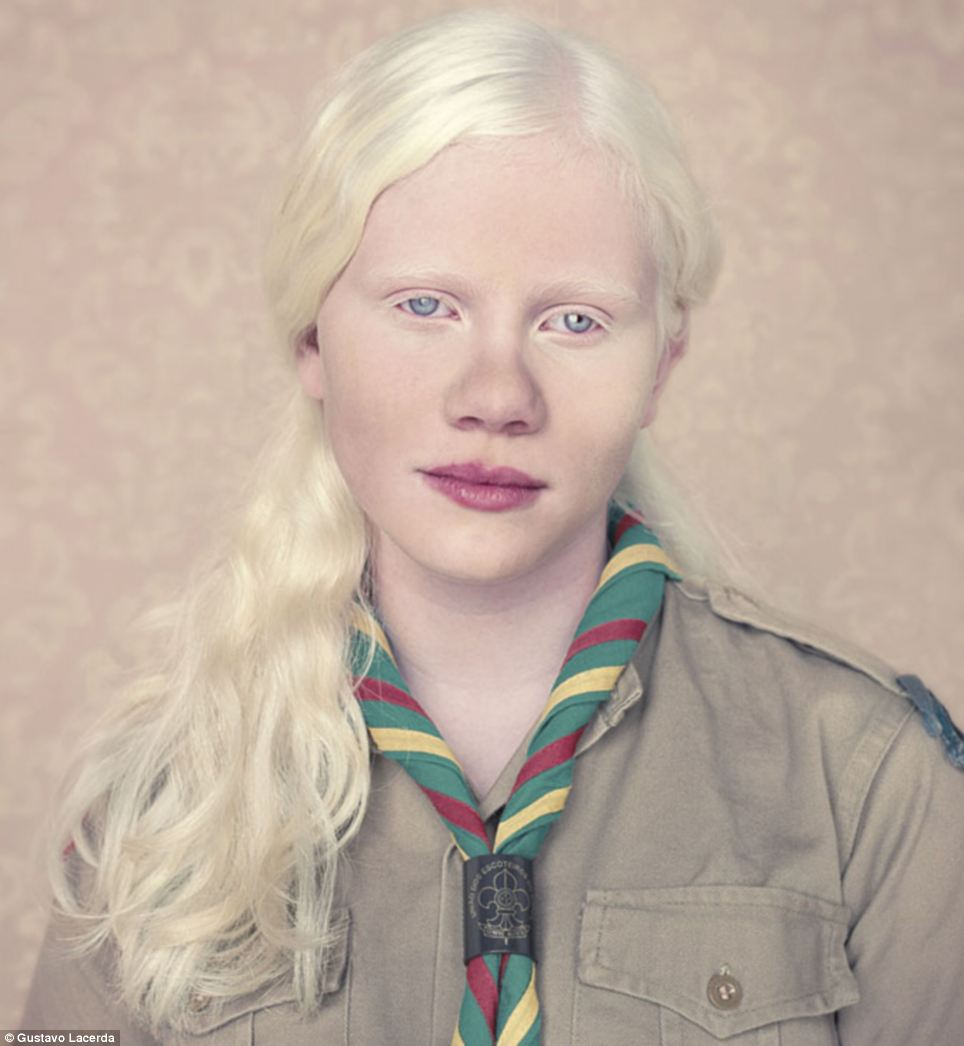 A young girl poses in her Girl Scout uniform