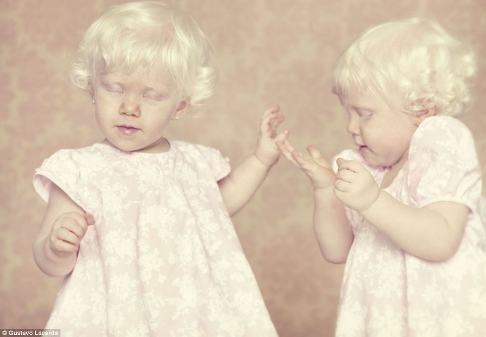 Pretty in pink: Two little girls in matching dresses snapped in an action shot