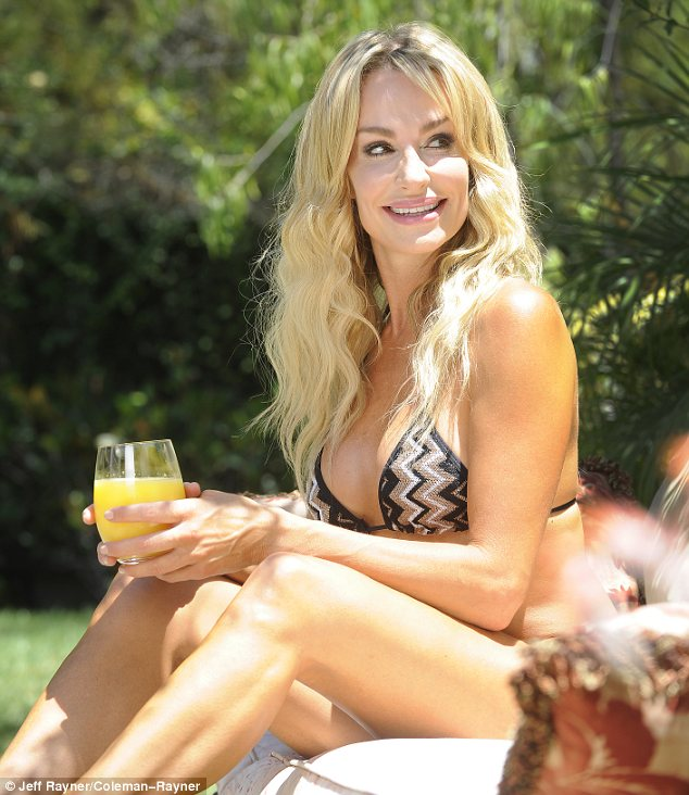 Refreshing: The blonde seemed in good spirits as she sipped on a cold glass of orange juice