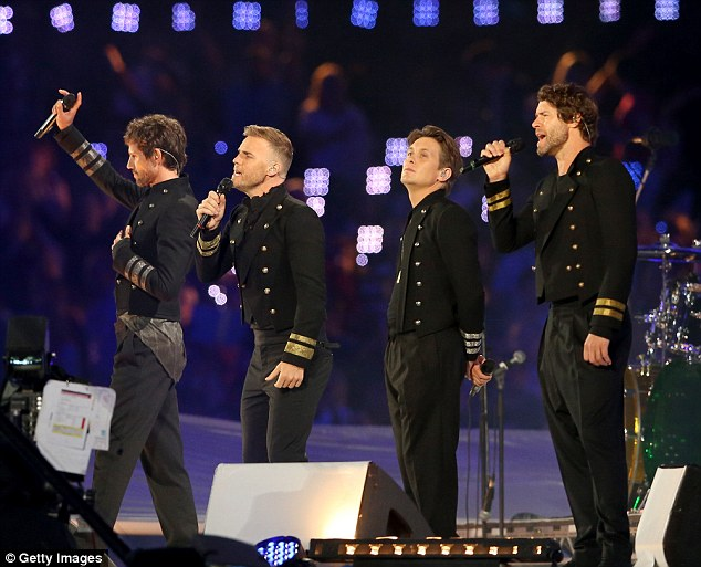 Super trooper: Gary bravely performed at the Olympic Closing Ceremony with the rest of Take That