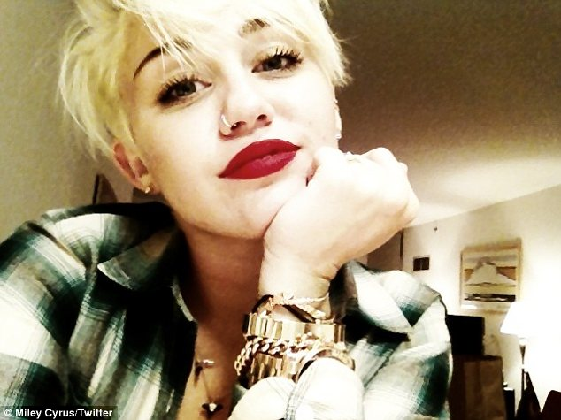 Going to her head: Miley is so besotted with her pixie cut she has incessantly posted photos of it to Twitter